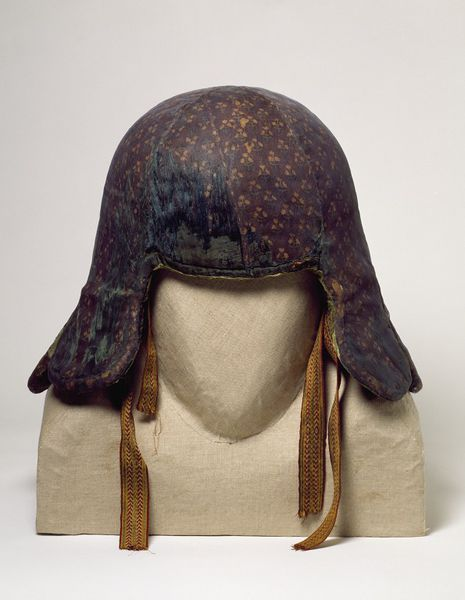 Helmet covered in smooth silk with flaps for the cheeks and back of neck