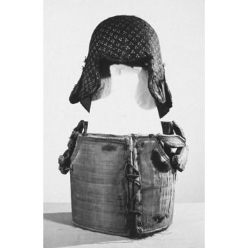 A black and white photo of a body armour and helmet of layered cotton 2 cm thick with a smooth surface