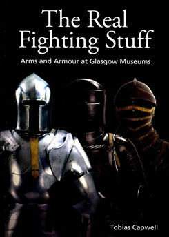 Photograph of the cover of the book with three suits of plate armour and a title