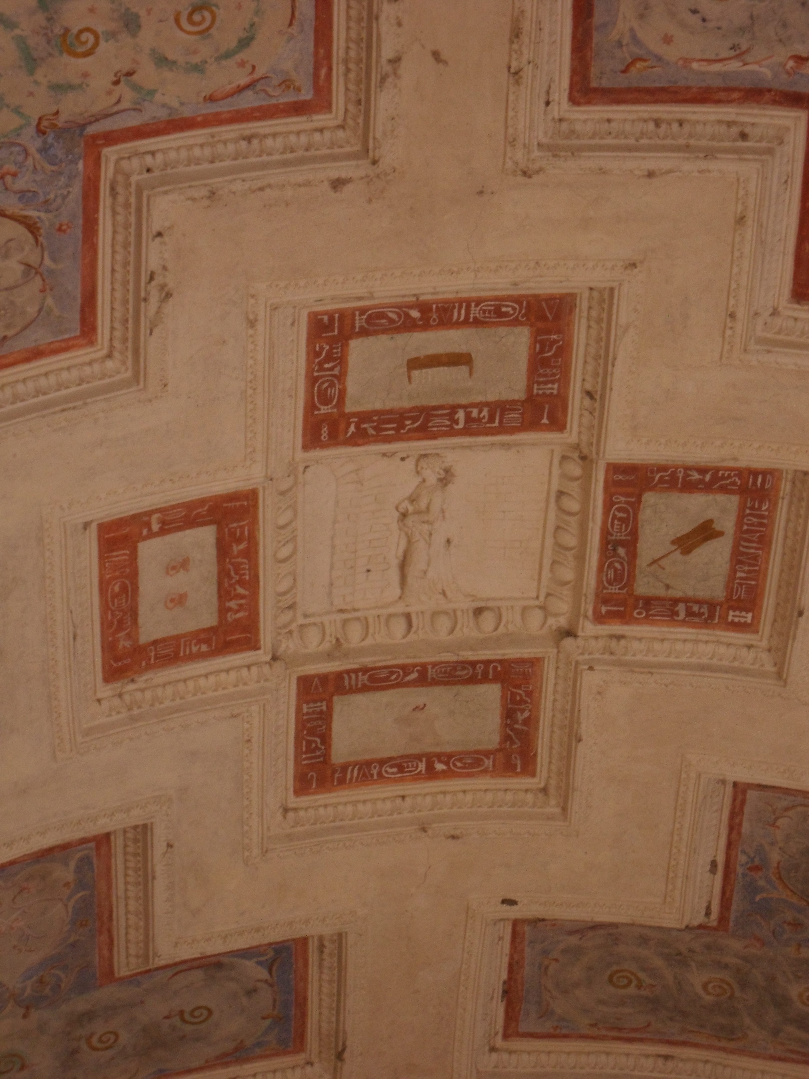A roof decorated with neo-classical reliefs and fake heiroglyphics