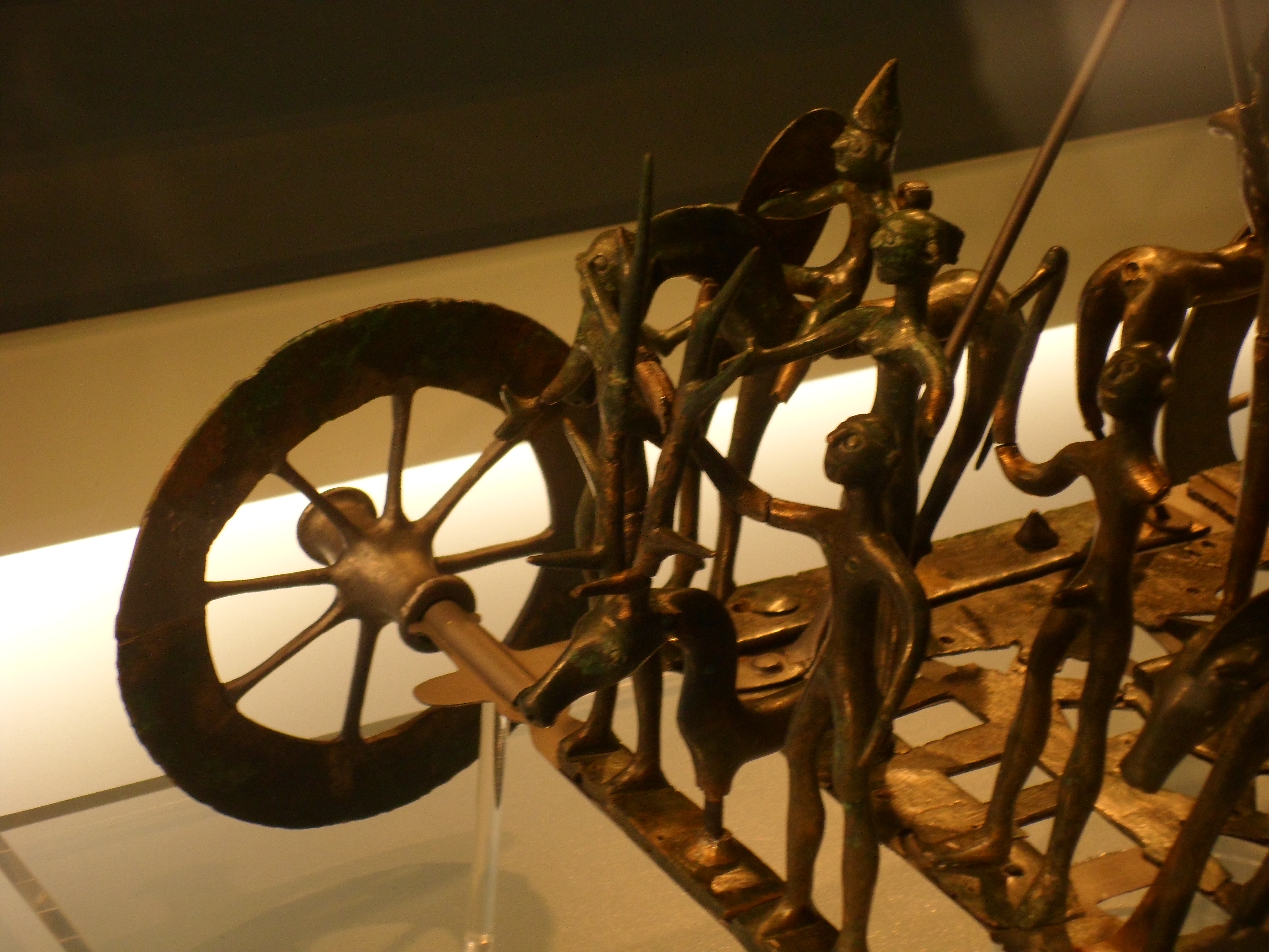 Detail of the bronze figurines standing on the base of the bronze wagon