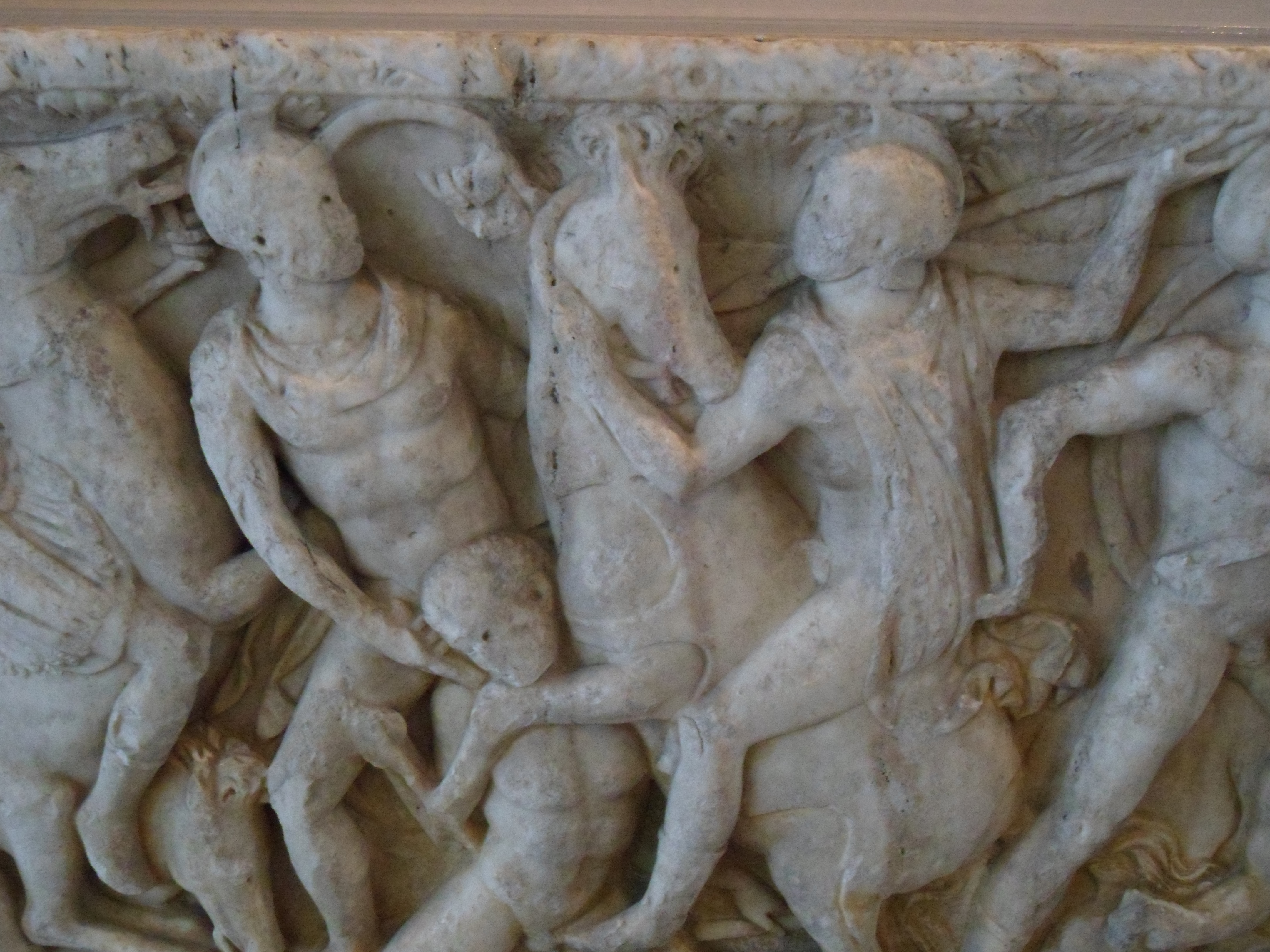 Relief of jumbled infantry and horsemen in Greek clothing fighting each other
