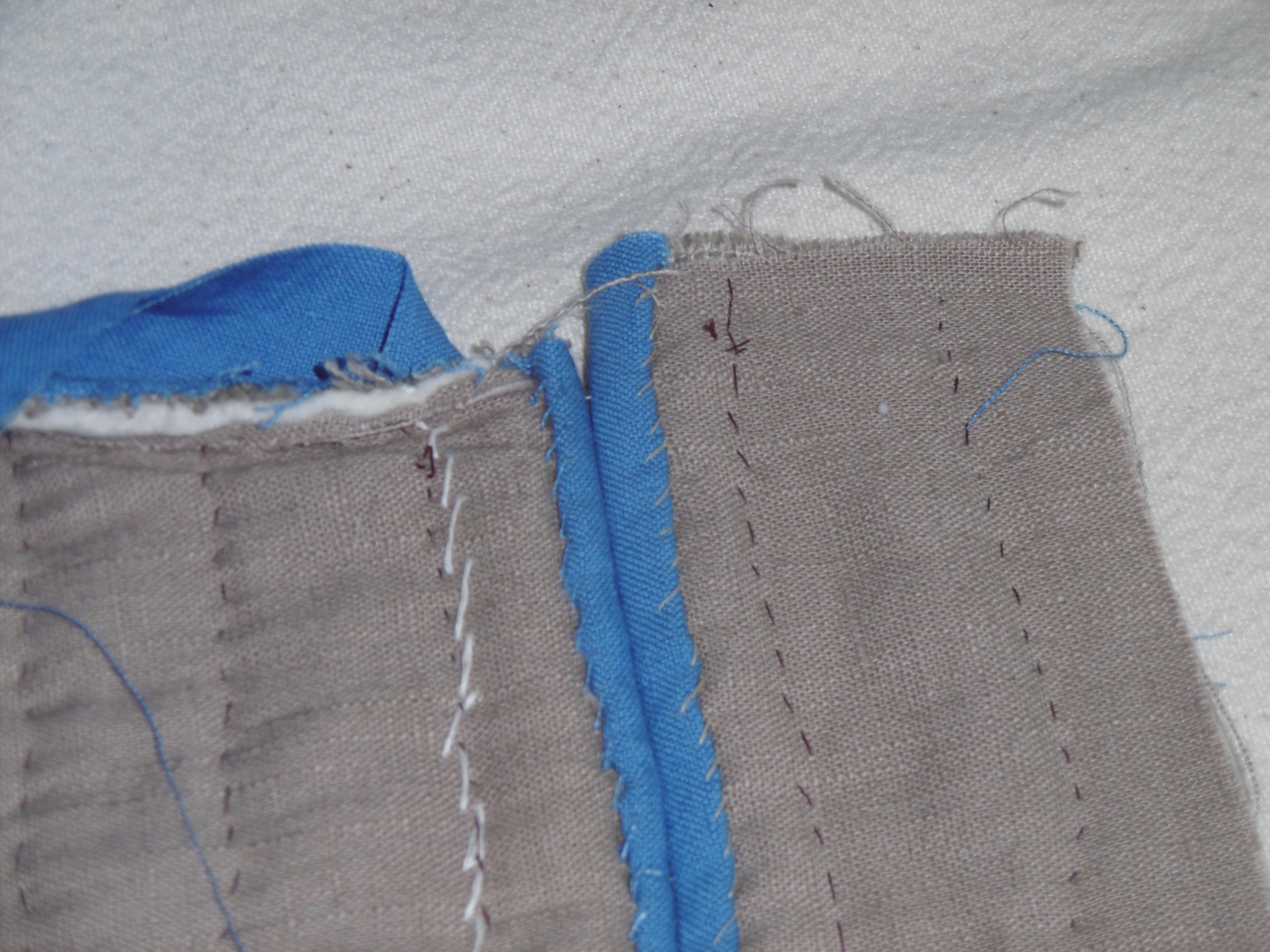 Detail of an unfinished sleeve of a quilted garment