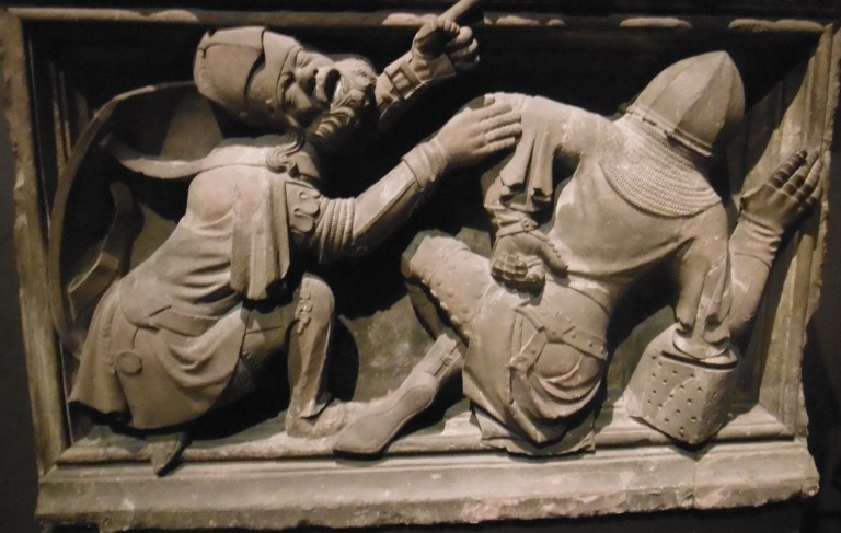 A sculpture of sleeping guards at the holy sepulchure in mid-14th-century armour