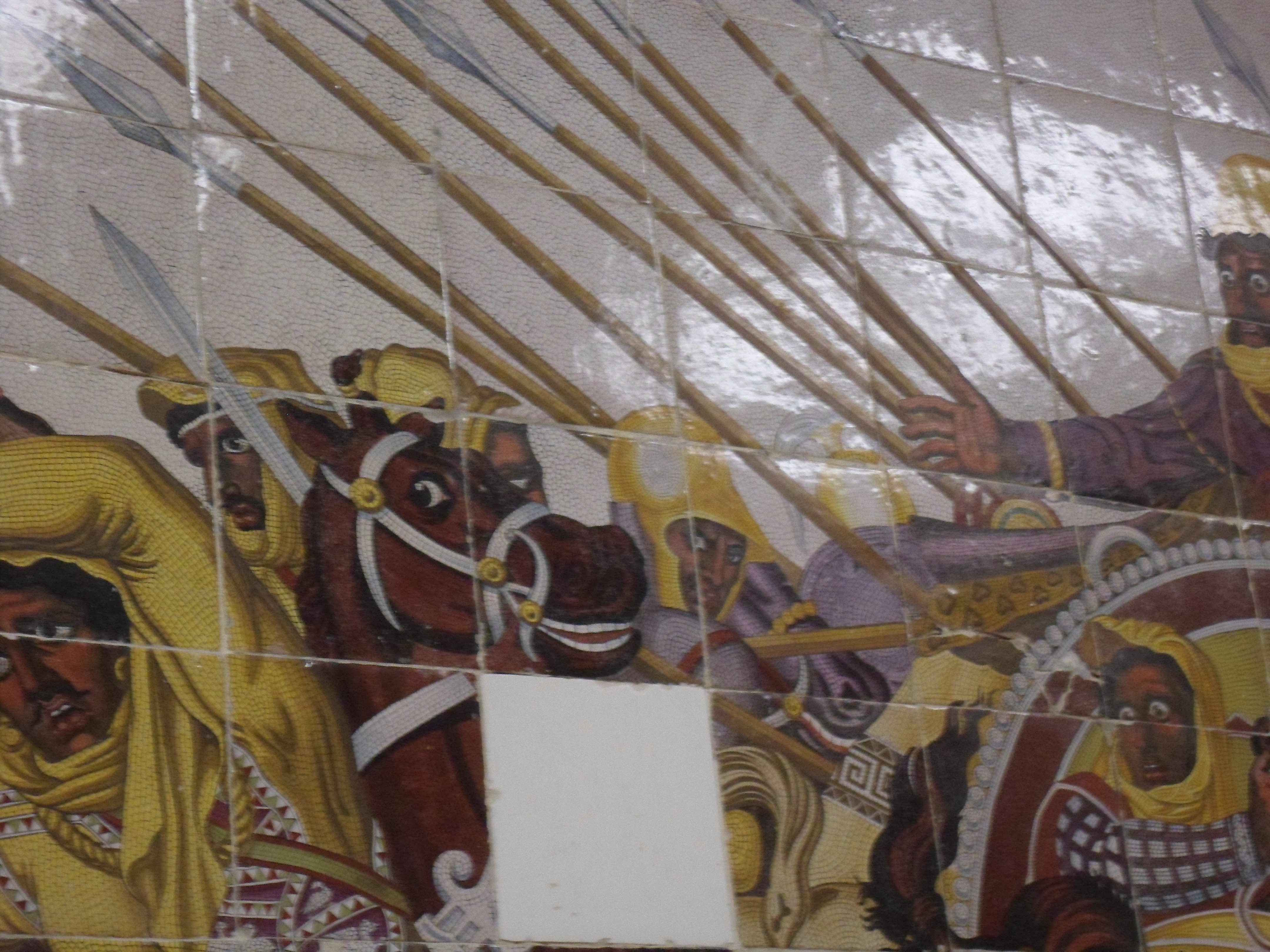 A reproduction of a battle between Persians and Macedonians painted on glazed tiles