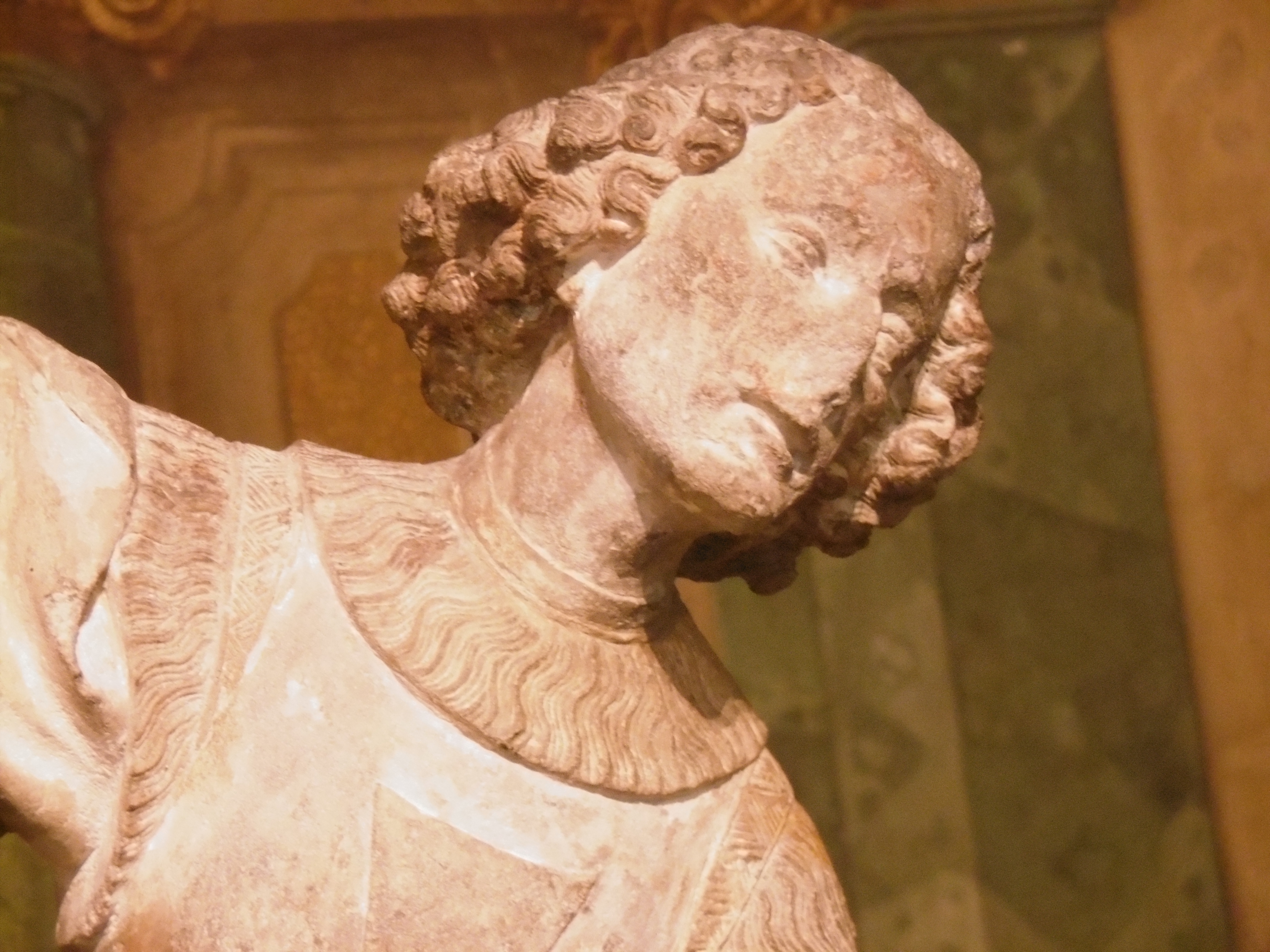 The face of a limestone statue of St. George in the Belvedere, Wien