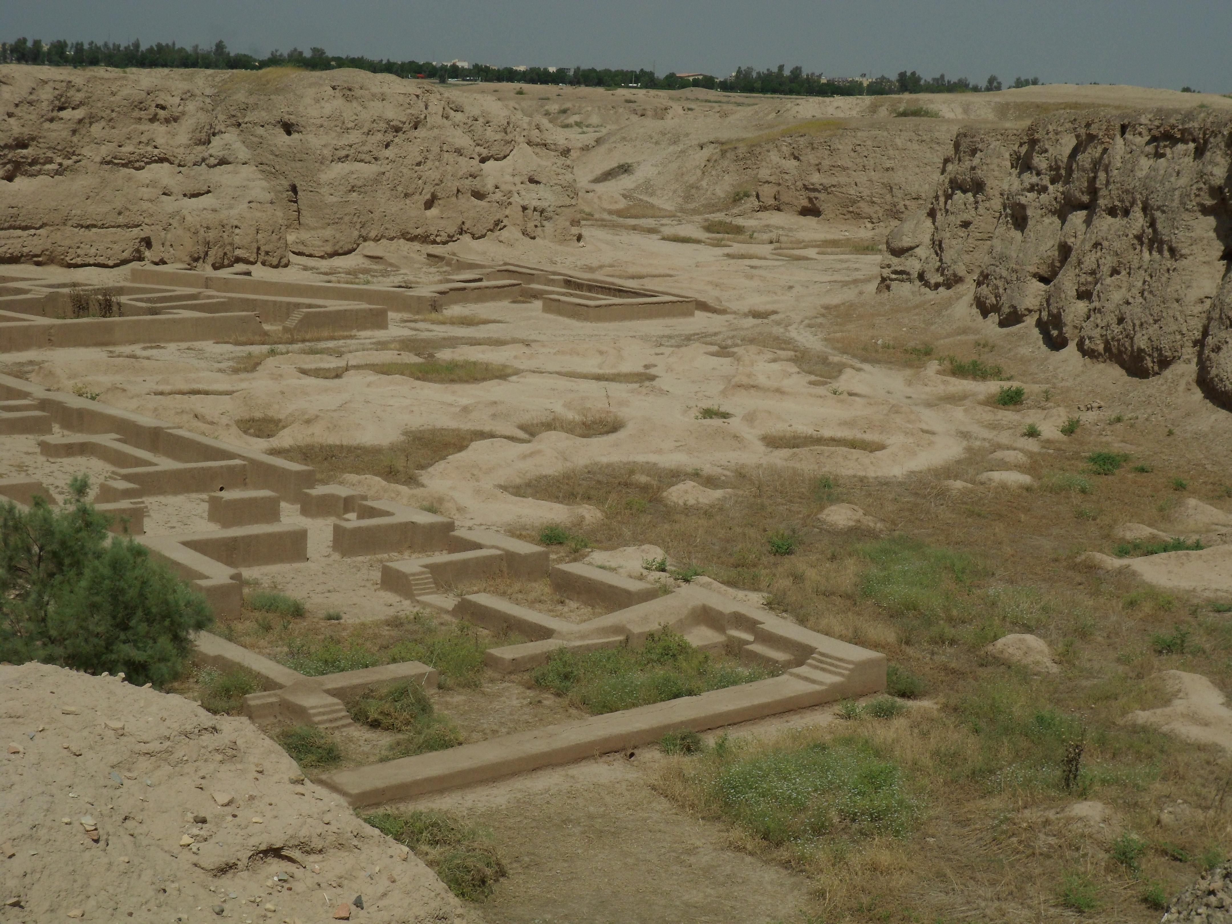 A gigantic excavation 6 or 8 metres deep with the foundations of mud-brick buildings at the bottom