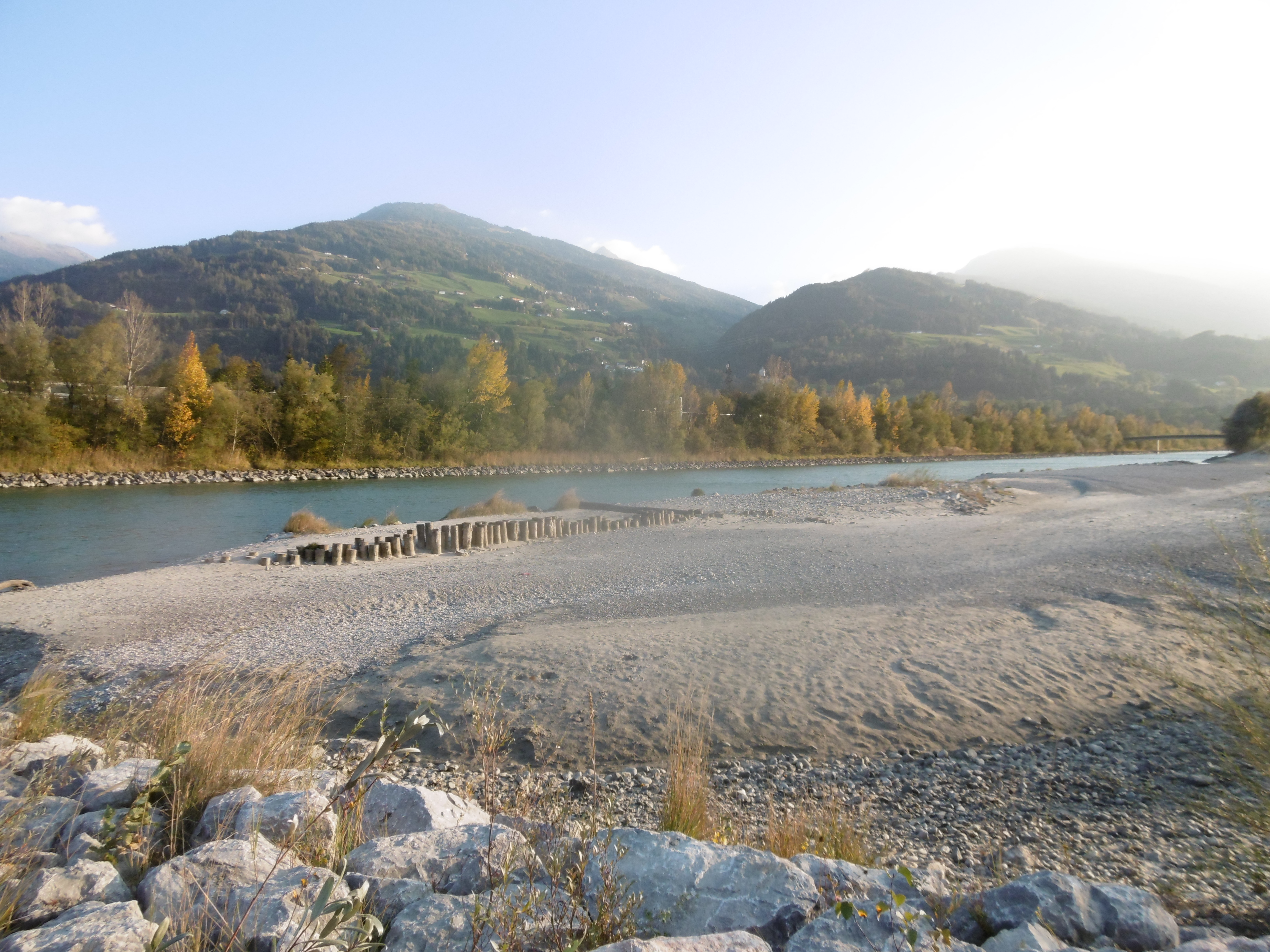 A broad, sandy beach reinforced with rows of piles