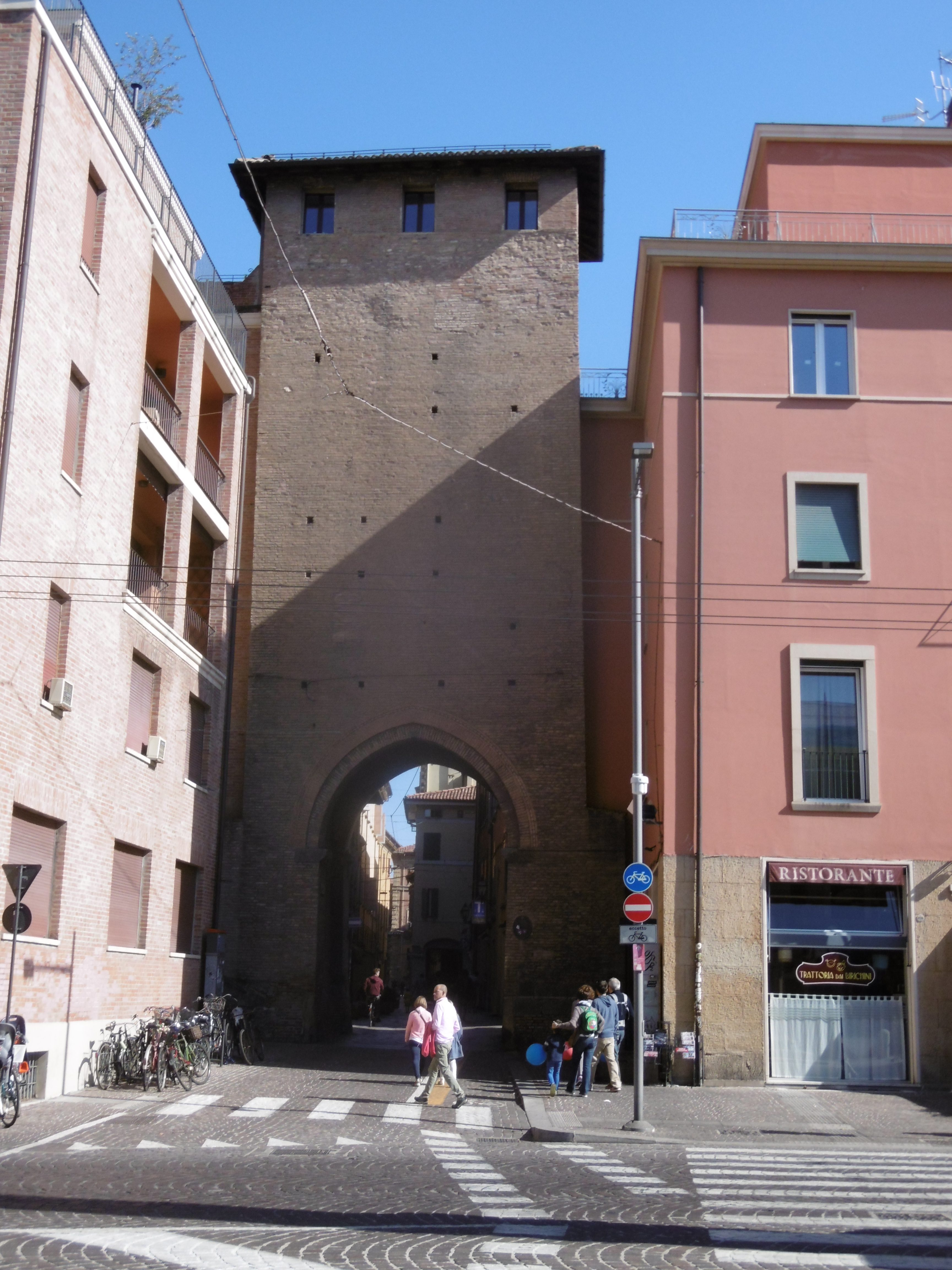 A gate tower six modern stories high with the gate passing through the ground floor