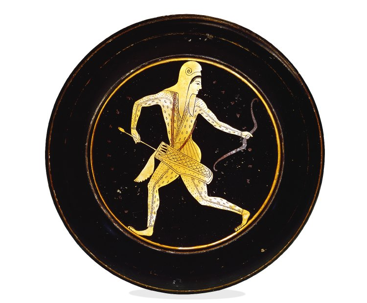 A Red Figure plate painted with an archer running right and looking left with a bow in one hand and an arrow in the other