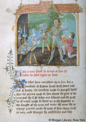 An illumination of a man standing next to a trestle table as a servant arms him
