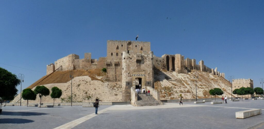 the stone-walled citadal of Aleppo on its steep hill